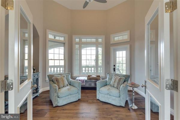 Luxury properties custom home with panoramic golf and lake views