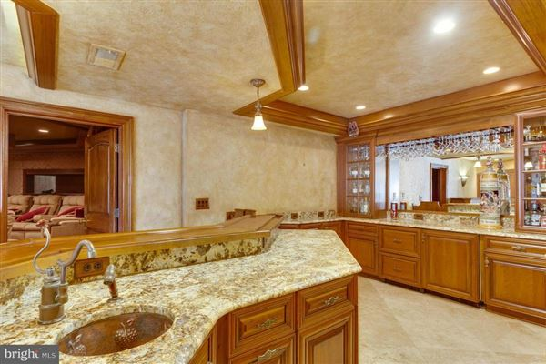 Luxury real estate custom home with panoramic golf and lake views