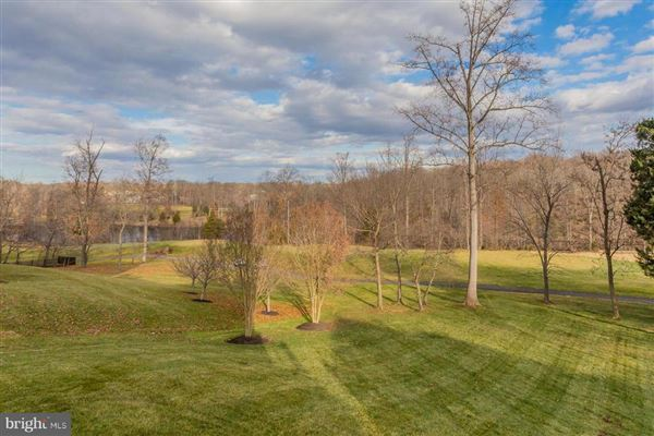 Luxury homes in custom home with panoramic golf and lake views