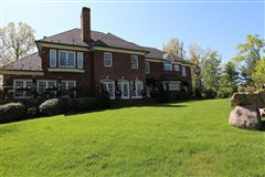 Exquisite brick estate with guest cottage mansions