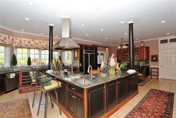 Luxury real estate Exquisite brick estate with guest cottage