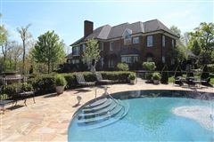 Exquisite brick estate with guest cottage luxury homes