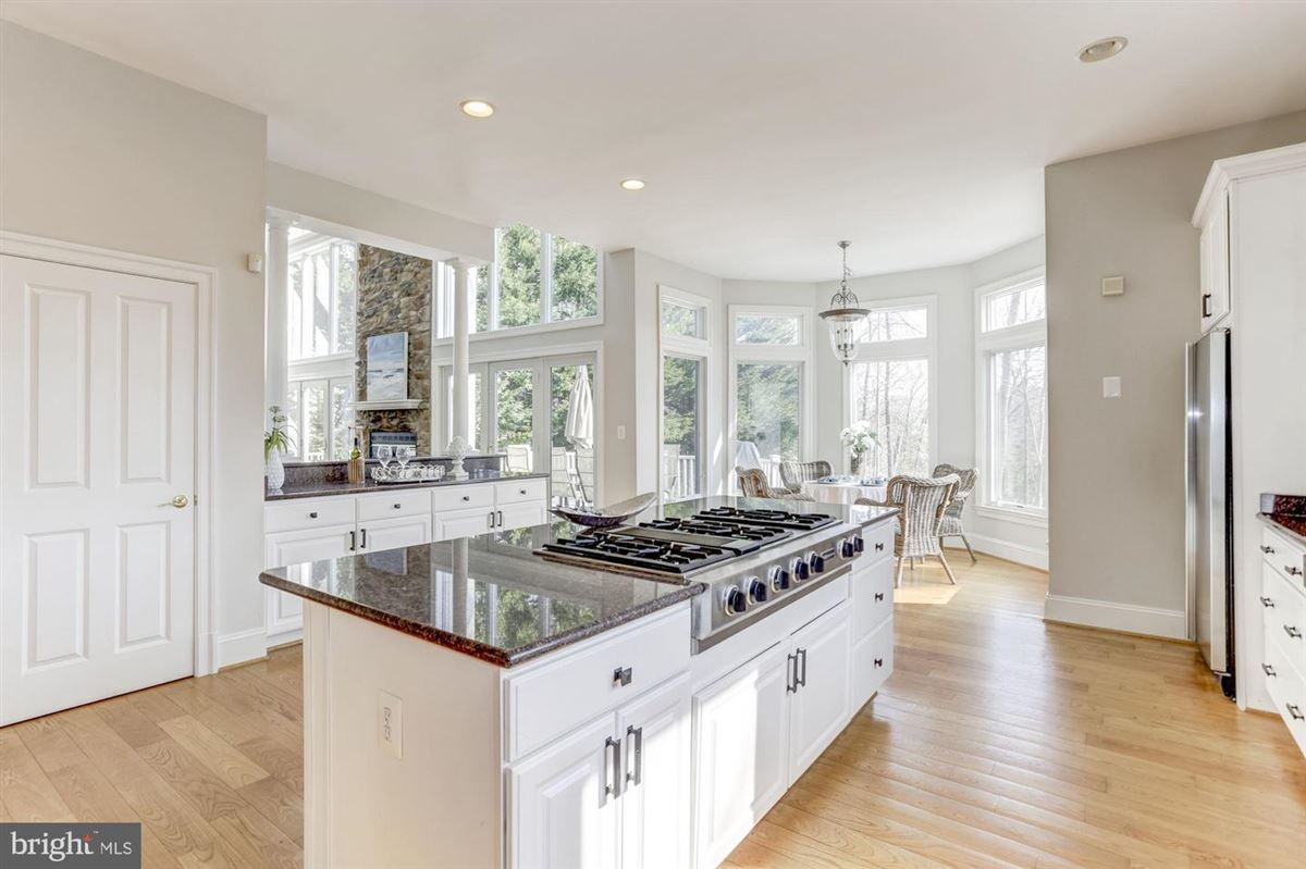 this exceptional home boasts private access to Beards Creek luxury properties