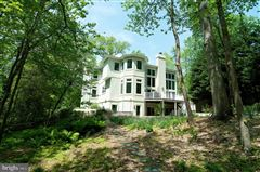 Luxury homes in this exceptional home boasts private access to Beards Creek