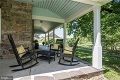 Luxury homes in 92 acre farm with 1776 historic stone home