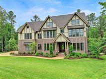 Luxury properties luxurious Tudor style home on majestic cul-de-sac lot