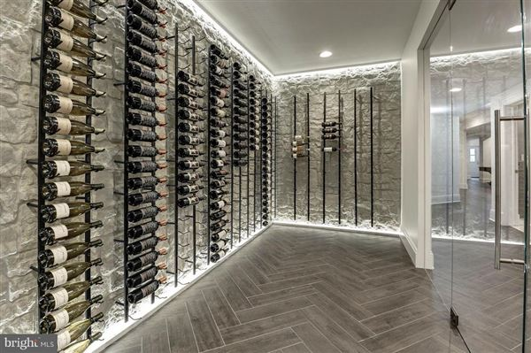 Luxury homes Gorgeous home offers a pool and envious wine room