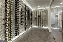 Gorgeous home offers a pool and envious wine room luxury homes