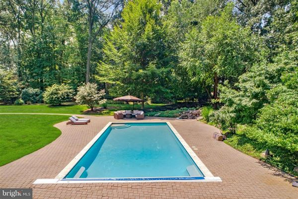 Gorgeous home offers a pool and envious wine room luxury properties