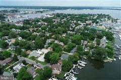 waterfront new construction with five boat slips luxury homes