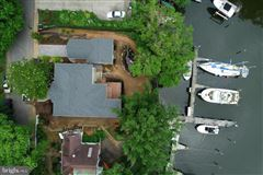 waterfront new construction with five boat slips luxury properties
