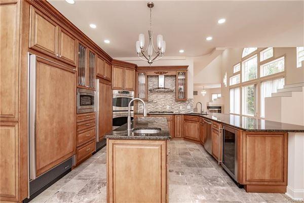 Luxury properties unique open-concept custom home