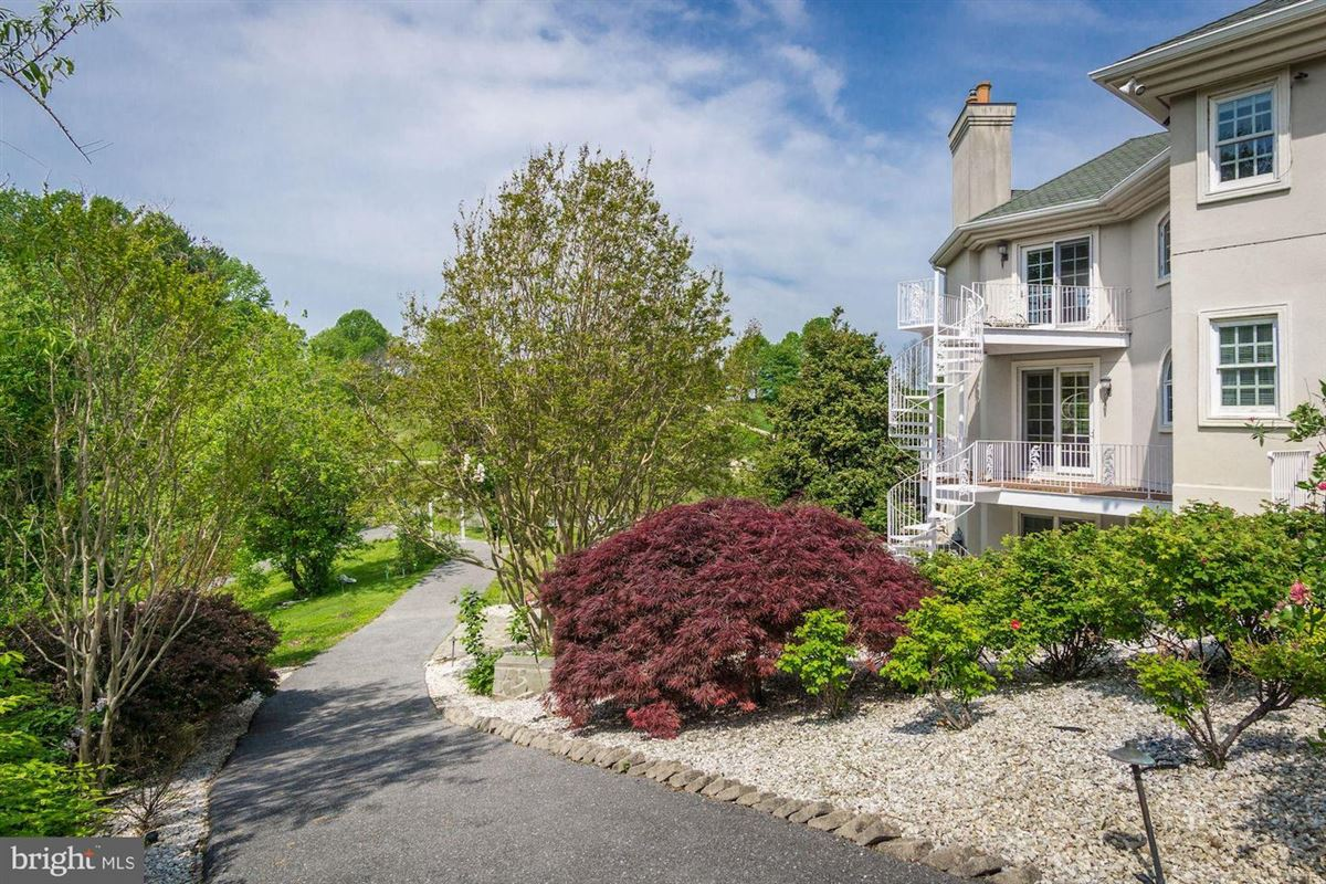 Luxury properties dramatic custom home in Old South Country Club