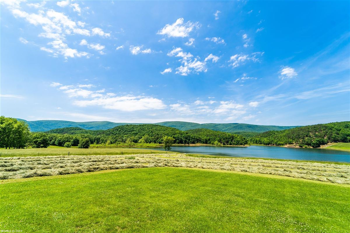Mansions in 203 acre retreat including private lake