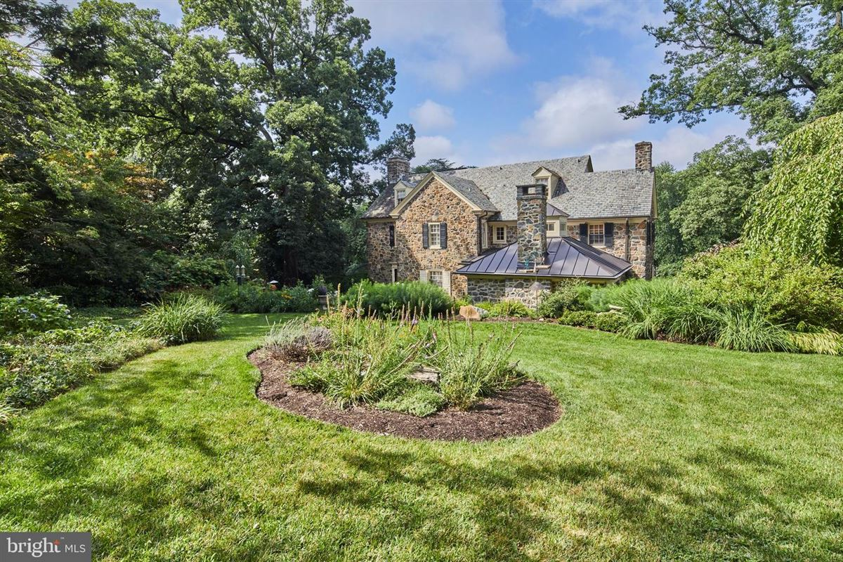 Luxury properties majestic stone home on a beautiful block