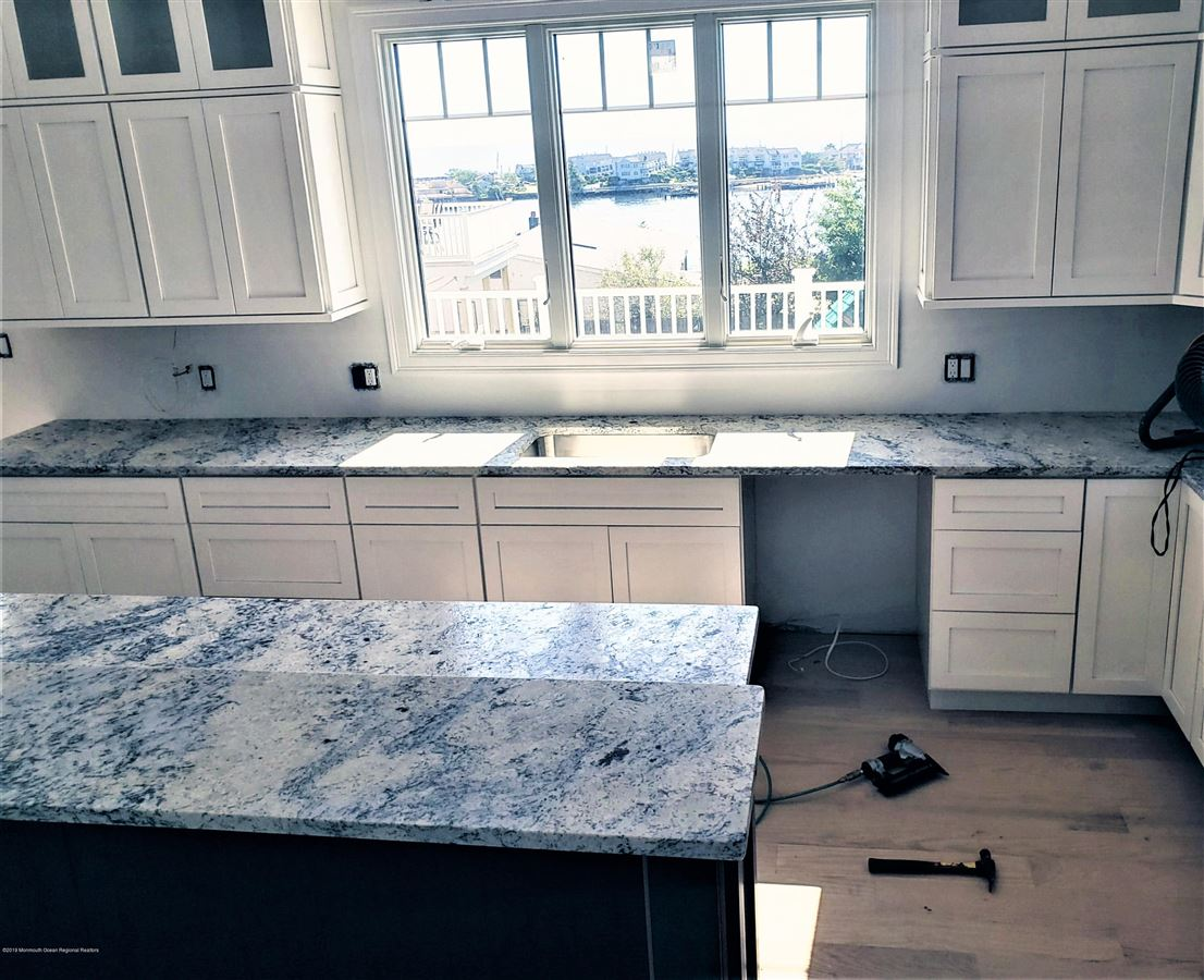 Luxury real estate new construction with water views and beach access