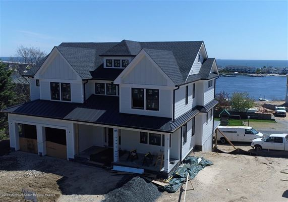 new construction with water views and beach access luxury properties