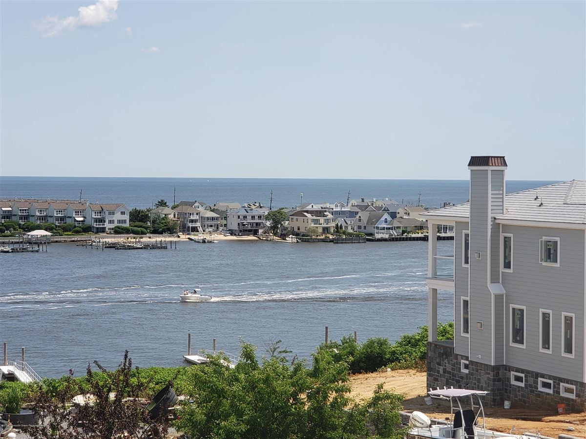 Mansions in new construction with water views and beach access