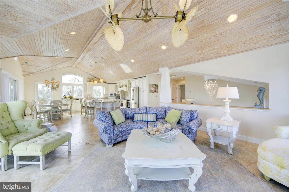 This elegant beach house is located just two lots from the oceanfront luxury homes