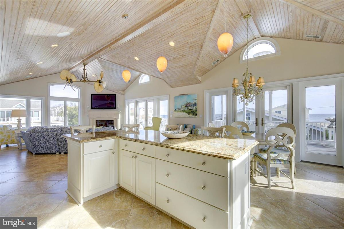 This elegant beach house is located just two lots from the oceanfront luxury properties