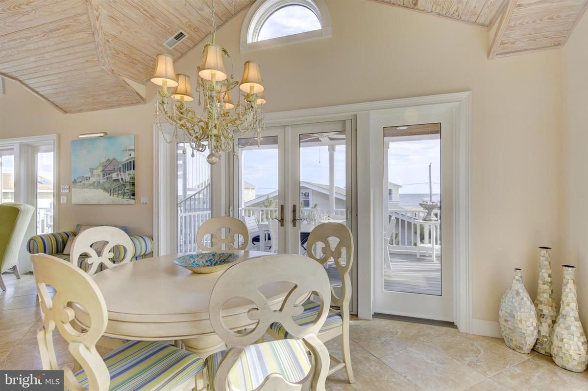 This elegant beach house is located just two lots from the oceanfront mansions