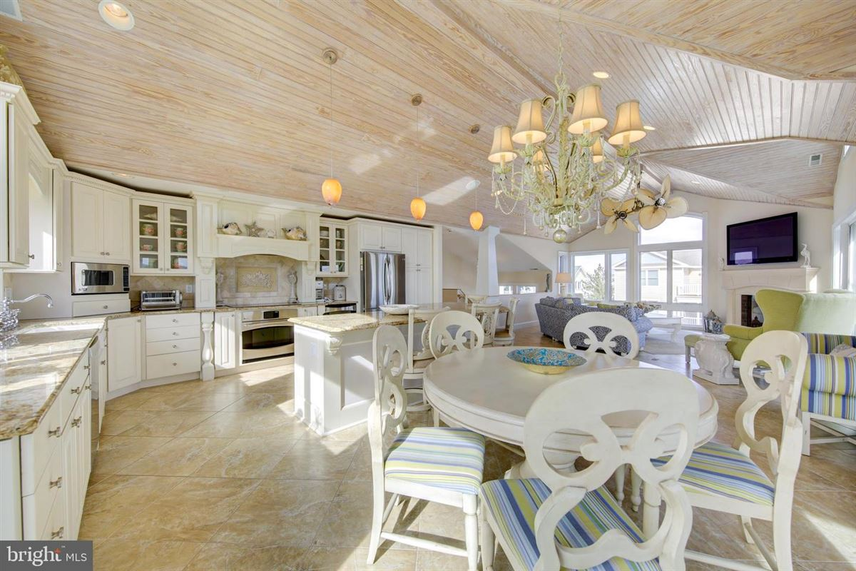 Luxury homes in This elegant beach house is located just two lots from the oceanfront