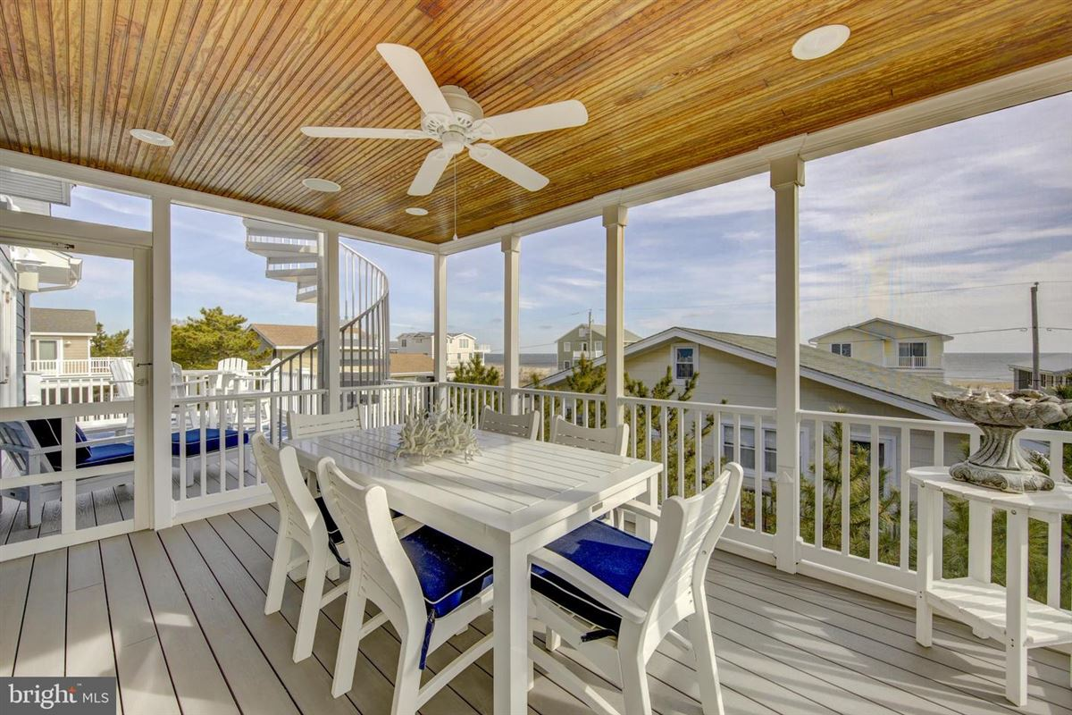 Mansions in This elegant beach house is located just two lots from the oceanfront