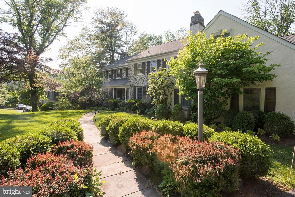 Luxury real estate stone colonial blending elegance with an easy lifestyle