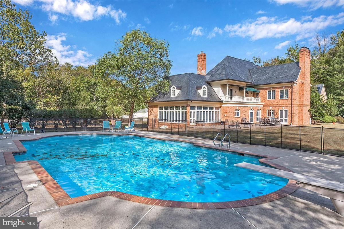 Luxury properties all brick waterfront estate home