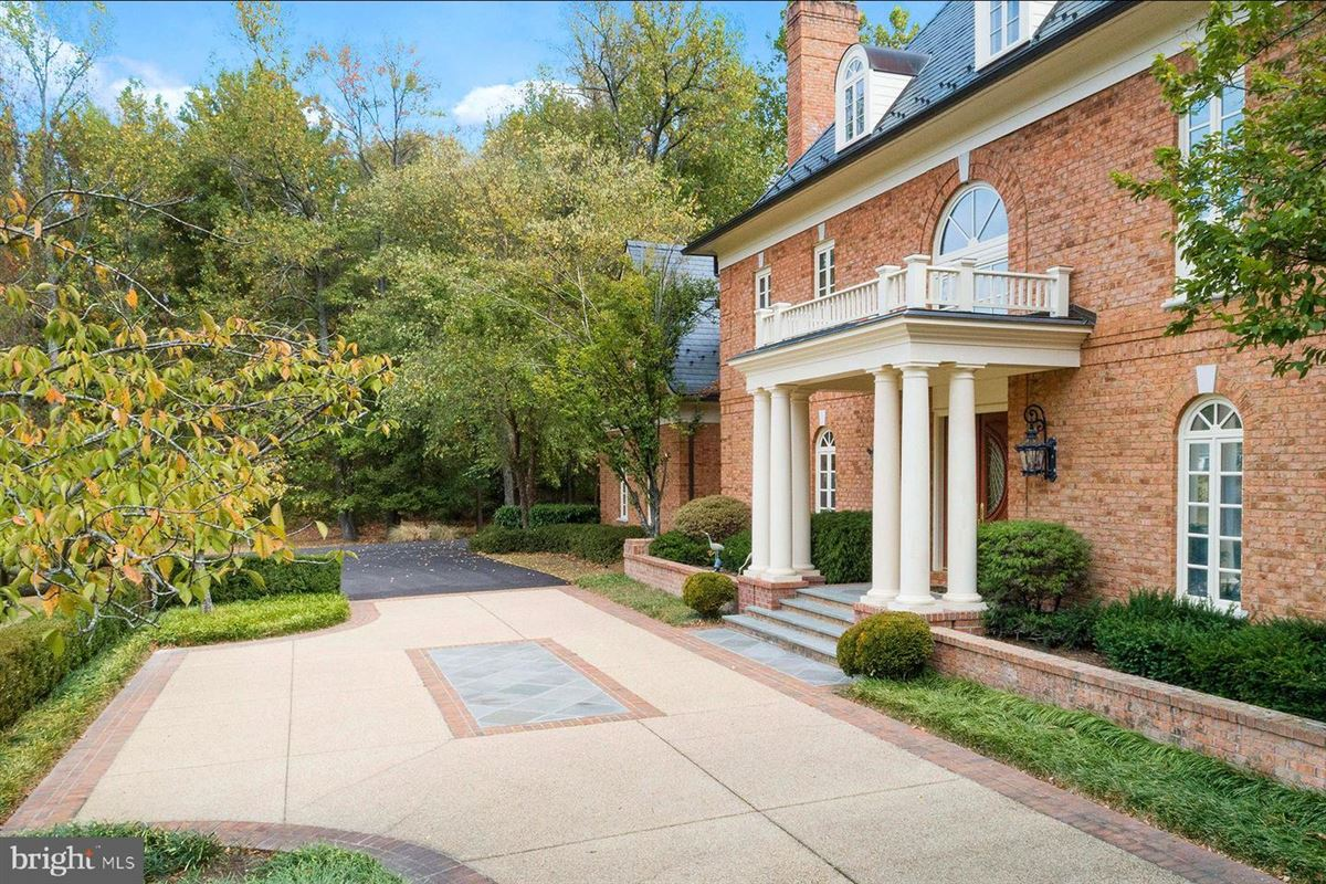 Luxury homes in all brick waterfront estate home