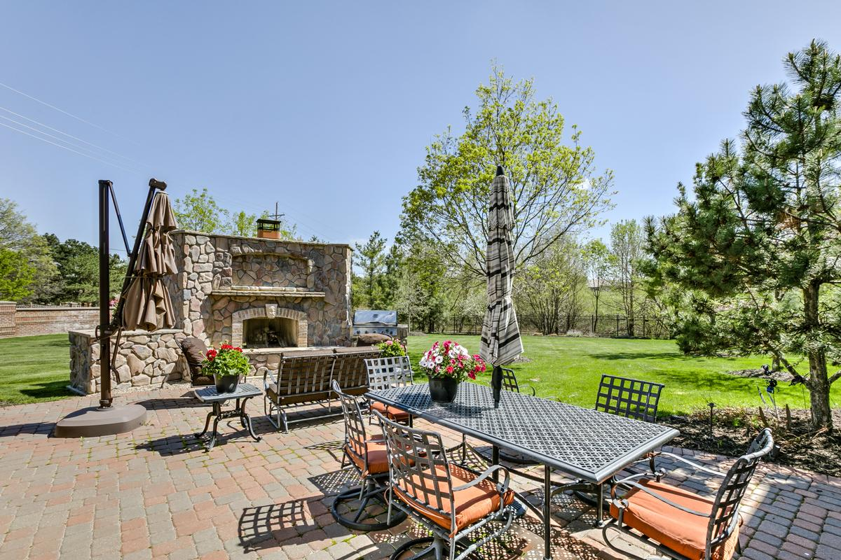 lovely home with outdoor fireplace and patio mansions