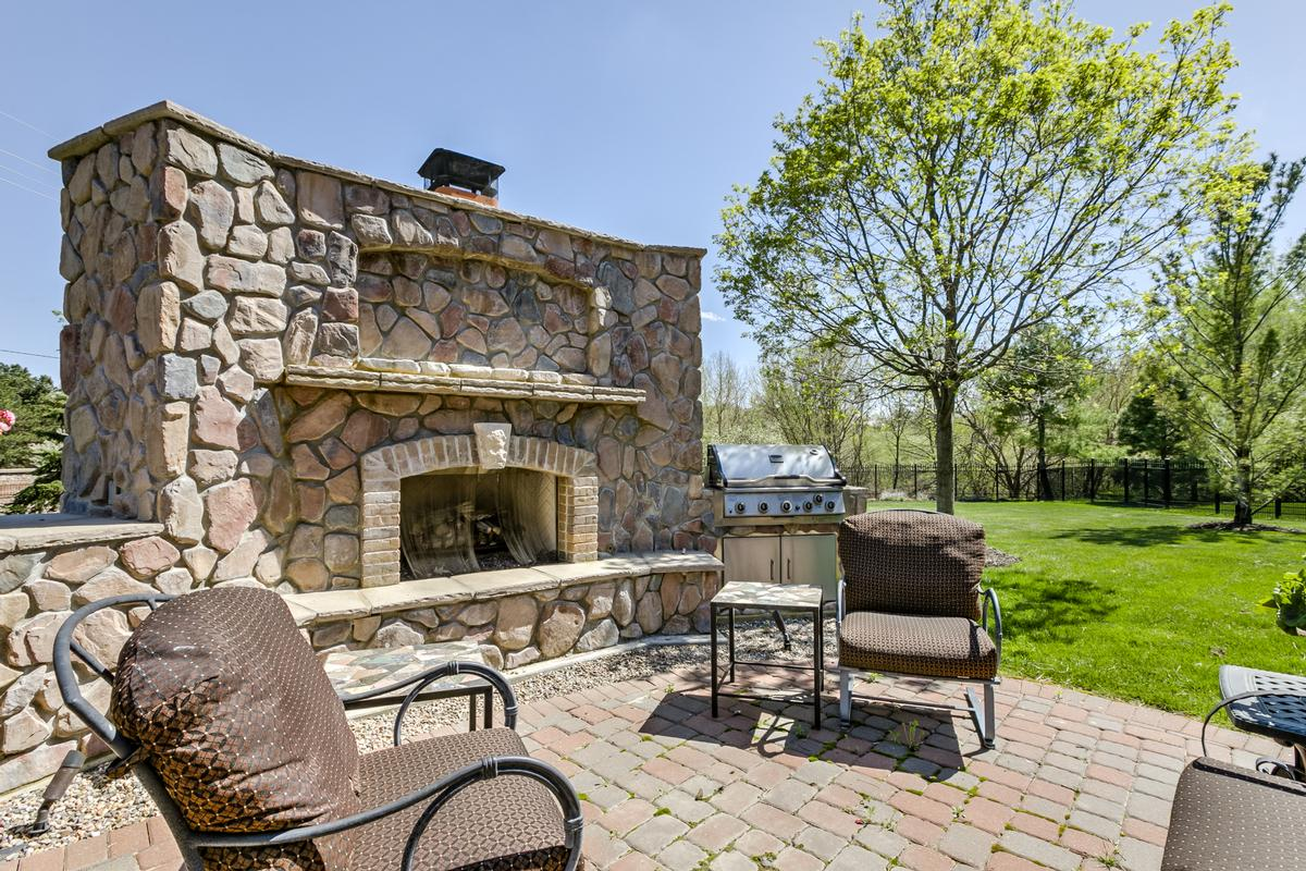 Luxury homes in lovely home with outdoor fireplace and patio