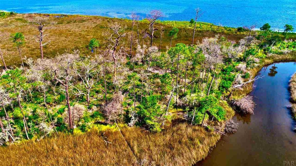 own a seven-plus-acre private island luxury real estate