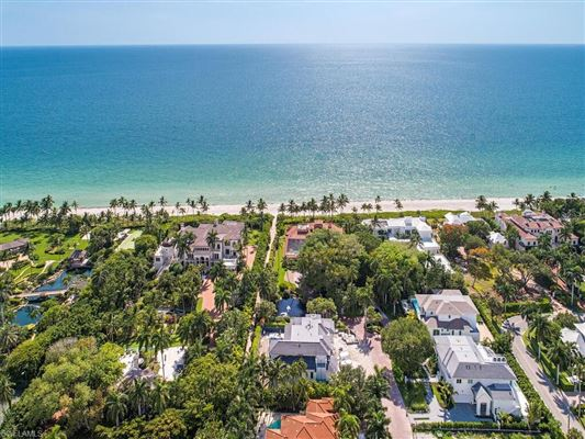 Luxury properties new home in gated beachfront enclave