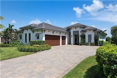 coastal contemporary in Talis Park luxury homes