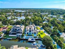waterfront new construction with wow factor mansions