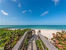 Your beach bungalow  awaits in the desirable neighborhood of Seagate luxury real estate