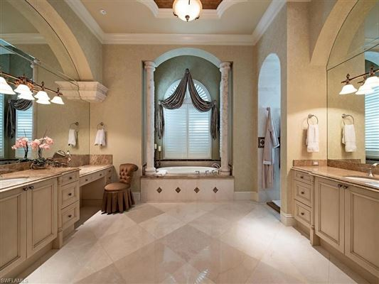 stunning residence in coveted Quail West luxury homes